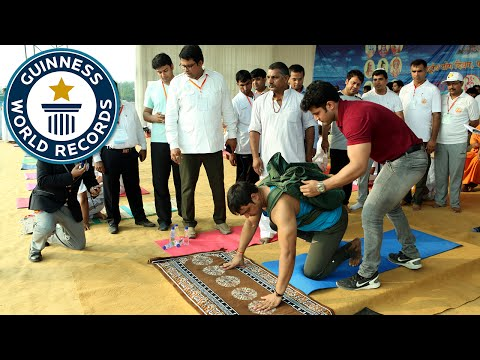 Most push ups in one minute carrying an 80 lb pack - Guinness World Records